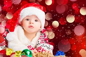 image of new years baby  - Beautiful little baby celebrates Christmas - JPG