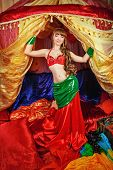 picture of belly-dance  - Sexy attractive oriental beauty dancing belly dance in front of the tent - JPG