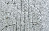stock photo of rock carving  - Carved Rock with Music String Pattern Texture - JPG