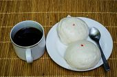 pic of fill  - Chinese Stuff Bun filled with meat ot pork with black coffee on bamboo plate - JPG