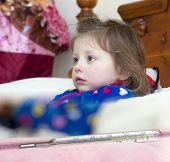 stock photo of high fever  - Mercury thermometer showing high temperature and a little sick girl in bed - JPG