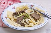 stock photo of nomads  - Beshbarmak is the traditional dish of the nomadic tribes of Central Asia made with horse meat hind quarters or rump wide cut pasta noodles onions and horse broth - JPG