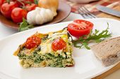 foto of kale  - Closeup of plate with one piece of fresh made frittata bread and tomatoes - JPG