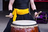 pic of traditional  - Group of japanese musicians are playing on traditional japanese percussion instrument Taiko or Wadaiko drums - JPG