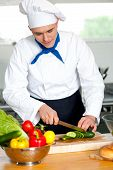 pic of cutting board  - Male chef cutting vegetables on cutting board - JPG