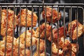 pic of roast chicken  - grilled roast meats chicken beef lamb fillet ribs on bbq grid over charcoal - JPG