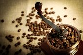 picture of wooden box from coffee mill  - Coffee bean grinder is on the burlap sack background - JPG