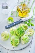 stock photo of brussels sprouts  - brussel sprouts on board and on a table - JPG