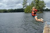 Little Girl Jumping Into Lake
