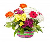stock photo of gift basket  - A bouquet of flowers in a basket of a gift on a white background isolated - JPG