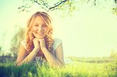 picture of grassland  - Beauty Romantic Girl lying on summer field Outdoors - JPG