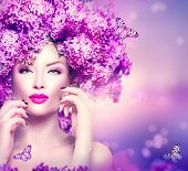 foto of butterfly flowers  - Beauty fashion model Girl with Lilac Flowers Hair Style - JPG