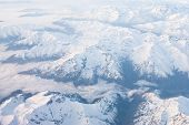 image of snow clouds  - Andes mountains with snow and clouds from above  - JPG