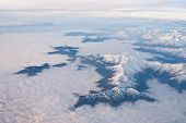 picture of andes  - Andes region cloudy from the sky  - JPG