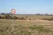 stock photo of restriction  - Forbidden tank sign on a restricted area field - JPG