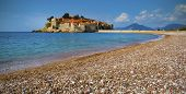 stock photo of crystal clear  - Beautiful crystal clear sea with black pebble beach at Montenegro - JPG