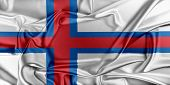 stock photo of faro  - Flag of Faroe Islands waving in the wind - JPG