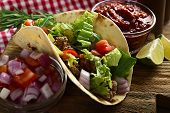 image of tacos  - Mexican food Taco on wooden cutting board - JPG