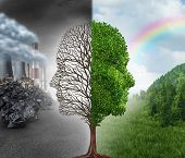 foto of global-warming  - Environment change and global warming environmental concept as a scene cut in two with one half showing a dead tree shaped as a human head with pollution and the opposite with healthy green clean air and plants - JPG