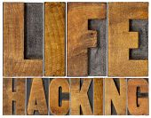 foto of hack  - life hacking isolated word abstract in letterpress wood type - JPG