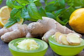 picture of grating  - Sliced and grated ginger root with lemon and mint - JPG