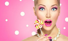 image of lollipops  - Beauty fashion model girl Eating colourful lollipop - JPG