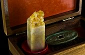 foto of curio  - Curio box with Chinese alabaster stamp and ancient coins - JPG