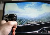 Постер, плакат: Hand on joystick playing flight simulator