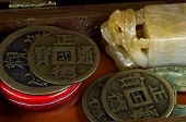 stock photo of curio  - Curio box with Chinese alabaster stamp and ancient coins - JPG