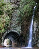 foto of blue ridge mountains  - a tunnel thru a mountain on the blue ridge parkway in north carolina at early spring snow melt - JPG