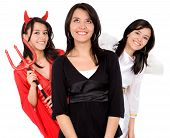 picture of angel devil  - good or evil girl over a white background with an angel on one side and a devil on the other - JPG