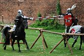 picture of jousting  - Two medieval knights jousting during a tournament - JPG