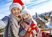 Mother And Daughter At Guell Park At Christmas Taking Selfie poster