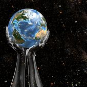 stock photo of planet earth  - Planet Earth held in cosmic star space by invisible translucent hands - JPG