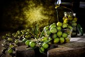 Freshly Harvested Fresh Olives Photographed On An Antique Wooden Table. poster