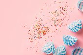 Multicolored Rainbow Sugar Sprinkles Cupcake Blue Paper Cups On Pastel Pink Background. Birthday Par poster