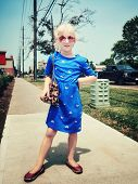 Young Little Girl Posing. Cute Adorable Stylish Caucasian Child In Blue Dress With Furry Bag Purse A poster