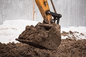 Close-up Of A Construction Site Yellow Excavator. House Construction. New Housing, Excavation, Road  poster