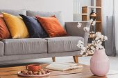 Closeup Of Elegant Wooden Coffee Table In Trendy Living Room Interior With Grey Sofa With Pillows poster