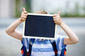Happy Little Kid Boy With Backpack Or Satchel. Schoolkid On The Way To School. Healthy Adorable Chil poster