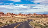 Long Winding Highway With Ups And Downs, Cloudy Blue Sky. Valley Of Fire Nevada, Usa poster