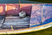 Part Of Old Weathered Fishing Boat With A Concrete Deadweight Anchor At The Kladovo Marina, Danube R poster