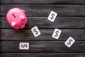 Moneybox In Shape Of Pig And Dollar Sign On Wooden Background Top View poster