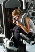 Young woman at fitness center exercise abdominal muscle gym machine
