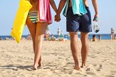 Back View Of A Couple Of Tourists Walking Arriving To The Beach On Summer Vacation poster