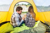 People, Summer Tourism And Nature Concept - Young Couple Resting In Camping Tent, View From Inside poster