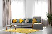 Stylish Living Room Interior With Comfortable Sofa. Space For Text poster