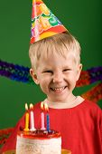 picture of birthday hat  - A happy boy on his birthday making a wish - JPG