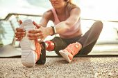 Stretching Exercises. Cropped Photo Of Young Beautiful Woman In Headphones With Leg Prosthesis Liste poster