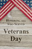 Veterans Day Greeting, Usa Patriotic Old Flag And Weathered Wood Background With Text Honoring All W poster